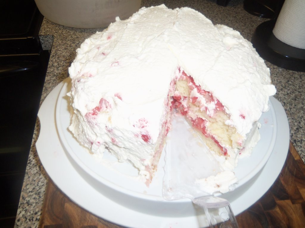 Jenny's strawberry cake - piece cut out